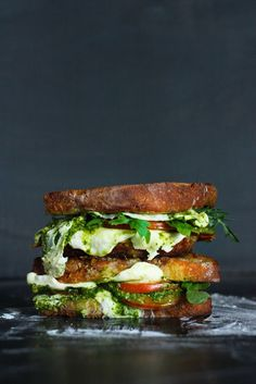 A delicious recipe for Grilled Caprese Sandwich with fresh mozzarella cheese, summer tomatoes and a flavorful Arugula Pesto.