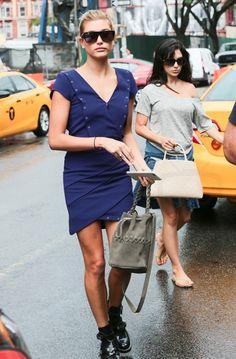 Hailey Baldwin Walking around Soho wearing the kooples wrap dress and saint laurent sunglasses