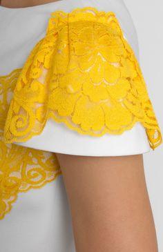 Thick cotton lace-trim dress. Boat neck. Decorative button placket. Hidden back zip closure. Belt with a designer handmade rose. Without pockets.