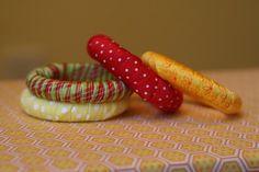 shower curtain rings + ribbon -> napkin rings!
