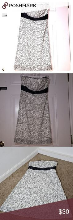White House Black Market lace black & white dress White House Black Market dress Size 6 Strapless   Beautiful lace dress has lining on the inside, black satin all the way around. Side zipper for opening. Floral design.  Has one barely noticeable descolartion on the inside (see last pic, it was hard to capture but if you pay attention you'll notice the small outline) since it's on the inside not noticeable to anyone else and the outside of the dress is PERFECT! White House Black Market…