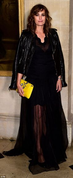 Yasmin Le Bon toughened up her look with a leather jacket and carried a bright yellow clutch