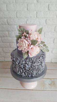 Pink and gray wedding cake.