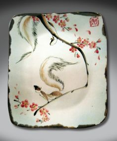 Intense and energetic glazing beneath the delicate petals of plum blossoms. HIgh-fire stoneware plate by Tracie Griffith Tso of Reston, Va.