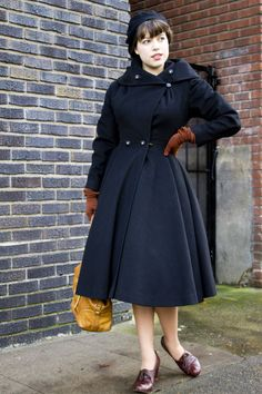A gorgeous vintage coat with great details and such a delightfully full skirt.