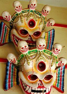 Citipatti - The lord and lady - Tibetan Skull Masks  kinkara, mask makers store wall, Boudha, Kathmandu, Nepal by Wonderlane, via Flickr