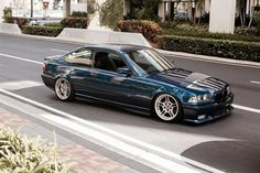 Avus blue BMW e36 coupe on OEM BMW Styling 66 wheels