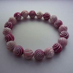 Bracelet élastique perles rondes mélanges de roses spirales argentées DIY