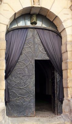 Krakow, Poland.  I Love double doors, and the curtain hangings look really cool