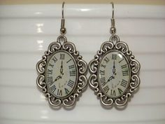 Handmade Oval Clock Earrings - Clock Face with Filigree Border - Shepherds French Wire Hooks - Gunmetal Finish. $10.00, via Etsy.