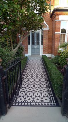 Front Doors: Victorian Black And White Mosaic Tile Path Battersea York Stone Rop. Front Doors: Victorian Black And White Mosaic Tile Path Battersea York Stone Rope Edge Buxus London Front Garden Victori. Front Gardens, House Front Door, House Front, Victorian Terrace House, Victorian Front Doors, House Exterior, Victorian Mosaic Tile, Victorian Front Garden, Front Path