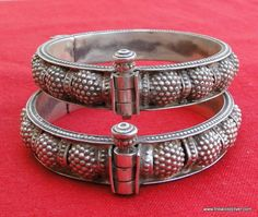 Ethnic tribal old silver hinge bracelet or bangle pair from Rajasthan India,worn by tribal people of Rajasthan. One quarter part can be opened by central pin. Beautiful Bangle pair in good condition,Great for your jewelry collection. Weight-88 Grams (3.09 ounce) Inner Diameter across-5.9 cm (2.32) Outer Diameter across-7 cm (2.75) Width-1.3 cm (0.51) Material-Sterling 92.5% Silver