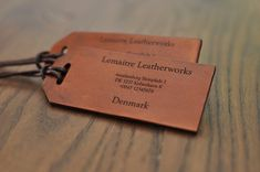 2 identical custom leather luggage tags, label with polished edges and laser ingraved text Leather Luggage Tags, Custom Luggage Tags, Leather Gifts, Leather Diy Crafts, Leather Projects, Leather Craft, Vegetable Leather, Tag Design, Small Leather Goods