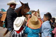 A group of students from the Garden Oaks Elementary School's Children's House met with trail riders from the Spanish Trail ride group including Haley Krampus, 19. The students had the opportunity to meet the trail riders, ask questions, touch horses and get a look inside a wagon.  Photo By Johnny Hanson/Houston Chronicle