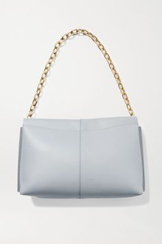 Wandler's '90s-inspired 'Carly' tote has been handcrafted in Italy from panels of supple leather in a sleek, rectangular shape. It's minimally detailed with the label's moniker stamped in gold foil at the front and suspended from a chain shoulder strap. The three internal compartments will keep your essentials organized. -- Light-gray leather (Cow) - Magnetic-fastening tab at top - Designer color: Mouse - Comes with dust bag - Weighs approximately 2.4lbs/ 1.1kg - Made in Italy