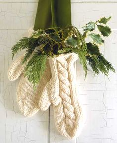 Be really cute with red Gloves! and red berries, pine branches, varigated holly and a vintage printed ribbon!