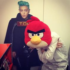 G-Dragon,T.O.P.-G-Dragon with an Angry Bird head and a cardboard cutout of T.O.P...... WHERE CAN I GET A CARBOARD CUTOUT OF TOP?!?!?!?!?!?