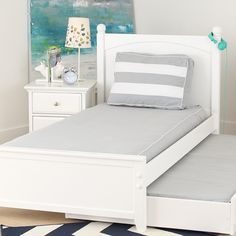 A classy grey mattress cover with white piping and a coordinating back pillow give a neat look to this twin bed. Mattress covers make great trundle bed covers too! Trundle Bed Mattress, Daybed Bedding, Daybed Covers, Mattress Covers, Spare Bed, Types Of Beds, Discount Furniture, New Room, Slipcovers