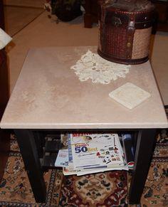 Second Hand end table with a new look.  faux finish on top/black on the bottom.