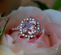 1.56ct Cushion Peach sapphire in 14k rose gold diamond. Beautiful.