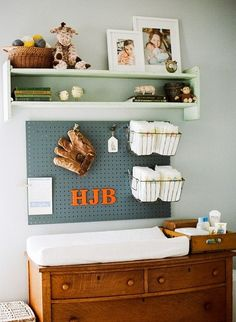 This is how I'm sorta picturing a boy nursery, only a bigger pegboard (darker oiled stained), and a vintage gas station/garage theme.