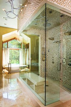Double shower heads And rainfall shower head AND a bench..
