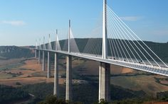Millau Viaduct, France 18 of 19   Looking down on clouds is to be expected from an airplane, but it's a bit more unsettling in a car. Yet that's often the sight when driving across this bridge, which is taller than the Eiffel Tower at its highest point. In fact, when it opened in 2004, it claimed the title of the world's tallest vehicular bridge.