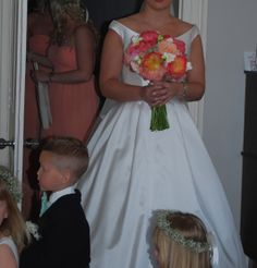 Beautiful bride and flower girls and pageboy at Barton Hall Orangery wedding, with flowers by  www.fieldgateflowers.co.uk