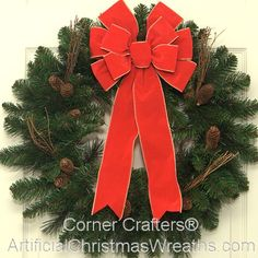 Deluxe Traditional Christmas Wreath - 2013 - Our Deluxe Traditional Christmas Wreath is made of a full artificial pine wreath base decorated with pine cones and twigs and is finished with a lovely over-sized bow. It will add a touch of old fashioned Holiday charm! - #TraditionalChristmasWreaths #ChristmasWreaths #ArtificialChristmasWreaths #Wreath #Wreaths