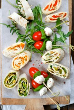 Delicious! Tortilla rolls and caprese skewers