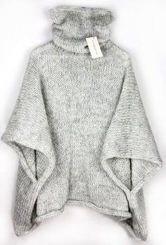 Poncho with turtleneck, made of soft, fluffy and cozy yarn in three colour: white, creamy and ashen which make beautiful melange effect. Best friend for autumn- winter walks.  Handmade. Clean by...