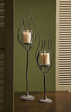 Designed exclusively for IMAX, the Anemone Candle Holders are an instant upgrade to the standard iron candlestick. The handmade pieces are sized to display pillar candles, and we include two in the… Unique Candle Holders, Candle Holder Set, Candlestick Holders, Candlesticks, Candleholders, Candle Lanterns, Candle Sconces, Sculpture Metal, Metal Shop