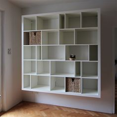 Expedit shelf 'reshuffled' & hung on the wall. Maybe we could do this with our unit! Would look great, I think.
