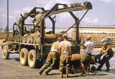 """M27 bomb service truck bringing """"air mail"""" for delivery to the enemy"""