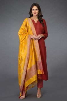From our exclusive collection of Banaras Threads, this is a mustard Banarasi zari handwoven dupatta paired with brick red pintuck & kantha hand embroidered pure silk kurta set. The mustard pure silk dupatta has banarasi rose gold zari weave f Salwar Designs, Kurti Designs Party Wear, Silk Kurtas, Asian Bridal Hair, Red Kurta, Beautiful Dresses, Beautiful Women, Classy Suits, Fancy Blouse Designs