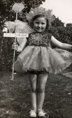 Little Miss Fairy Dewdrop. Sparkly little girl in a fairy costume, vintage photo.