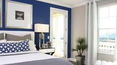Accent walls are trendy in 2014. Accenting a wall with a bright pop of color can do so many great things for a room, don't you think? Try colors like Royal Blue (pictured), Yellow, Orange, Red, Magenta and even Green.