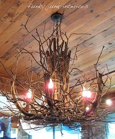 "DIY chandelier twig crafts    Hmm...this might inspire an idea for what to do with the light in Jason's bedroom if we decide to go with the ""log cabin"" theme we're tossing around. Rustic!"