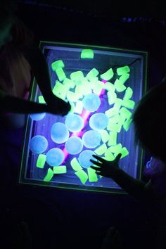 Glow ice!      The green ice cubes are frozen glow water and the white/blue looking ones are frozen tonic water.