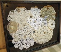 Old Doilies and Button, displayed in a frame.