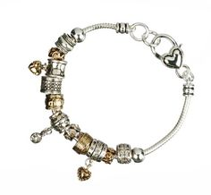 Eclectic beads in mixed metallics line a silver-tone snake chain to form this charming bracelet. It fastens with a heart-embellished lobster-claw ...  $19.00