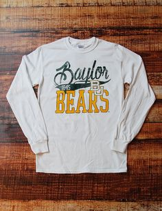Don't you just love classic T-shirts? Obviously because you're staring and this one pretty hard! With this Baylor Bears long sleeve t-shirt, you will look super classy! Dress it up, Dress it down, Wear this bad boy all around! Sic 'em Bears!