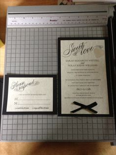 Homemade wedding invitations and rsvps's, spent around $50 for everything :). Items include: black construction paper (Walmart), ivory resume paper (walmart), black ribbon (michaels), heart stickers (michaels), glue dots (michaels) and free printable wedding invitation and RSVP  templates (weddingchicks.com).