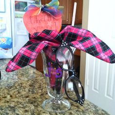 Just did this for my daughter ... Party favor for 50s theme party - soda fountain glass, scarf, & cat eye glasses with thank you note on a lollipop.