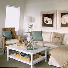 clean, comfortable furnishings in the LR— slipcovered sofas and a wicker chair—azure-and-taupe pillows from Pottery Barn, added texture of burlap& wood/wicker -- give a cottage-by-the-sea feel. ----Simple accents, such as a tray full of shells, glass jars, and conch artwork in matching whitewashed frames reinforce the calming look. | Keep It Light and Airy | CoastalLiving.com