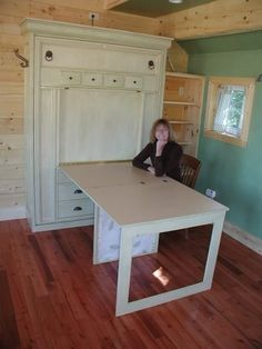 Murphy bed table. This would be amazing in an office that doubled as a guest room :-)