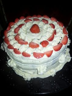 Red Velvet Cake with cream cheese frosting decorated with strawberries. (No recipe)