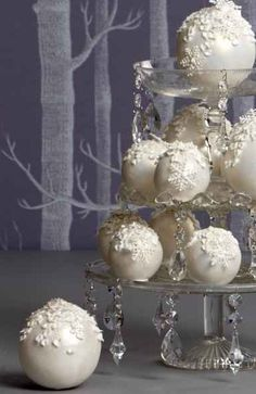 Place ornaments on crystal cake tiers for a unique centerpiece