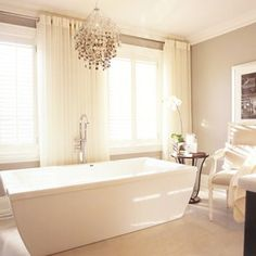 I'm getting more and more fond of a plain white bathroom. So tranquil!