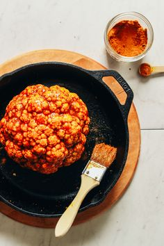 The Best Whole Roasted Cauliflower Ingredients!) Using a pastry brush to spread oil and spice mixture onto head of cauliflower Whole Roasted Cauliflower, Cauliflower Recipes, Cauliflower Salad, Shawarma Spices, Harissa, Minimalist Baker, Baker Recipes, Cake Ingredients, How To Cook Quinoa
